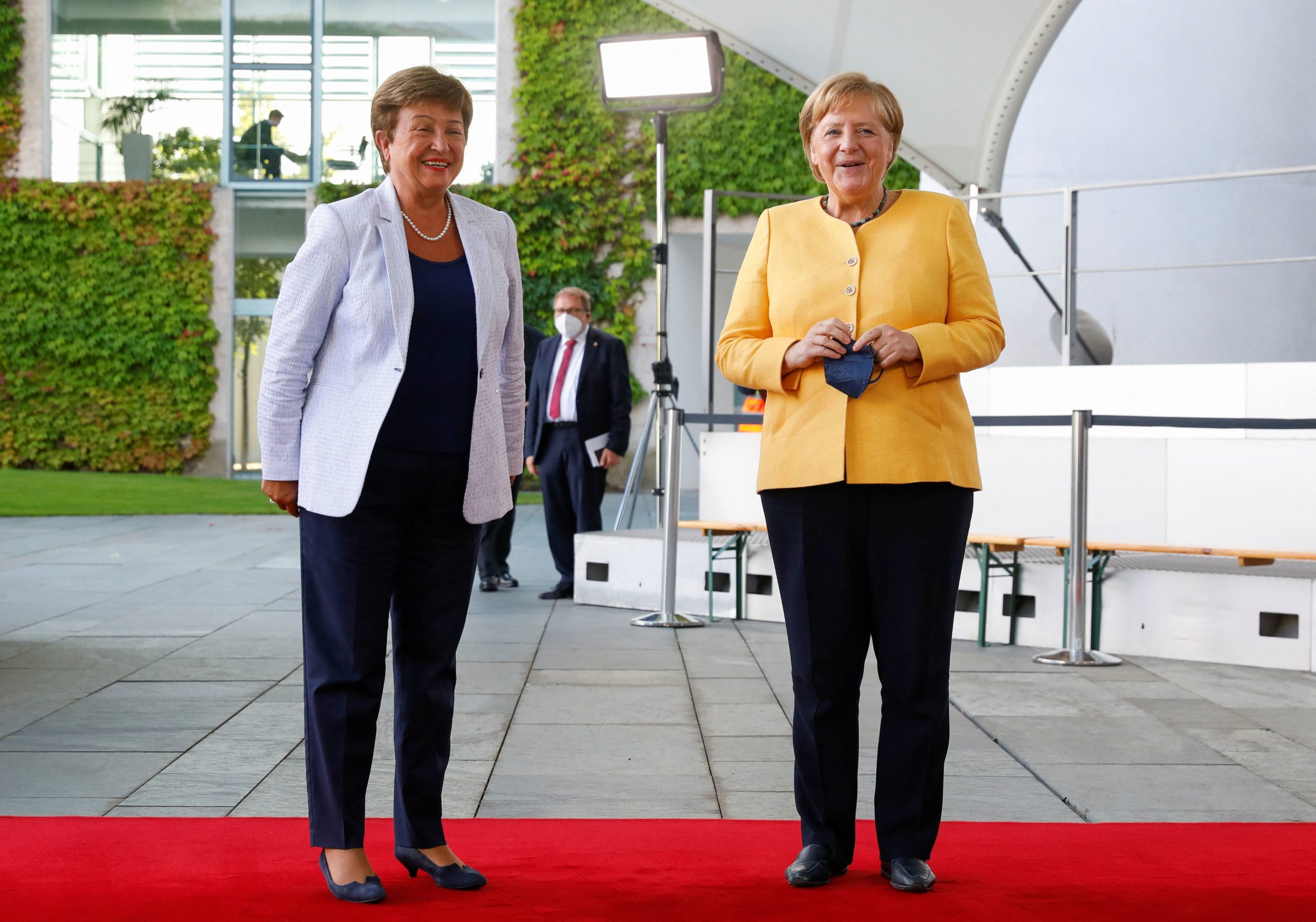 German Chancellor Angela Merkel welcomes IMF Director Kristalina Georgieva to the G20 Compact with Africa meeting in Berlin on Aug. 27. (Michele Tantussi/Pool/AFP via Getty Images)