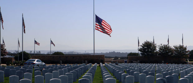 SAN DIEGO, CA - AUGUST 27: A flag flies at half staff at Miramar National Cemetery on August 27, 2021 in San Diego, California. Over 170 civilians were killed, including 13 U.S. Servicemen during an ISIS led terrorist attack outside of the Kabul Airport. (Photo by Sandy Huffaker/Getty Images)