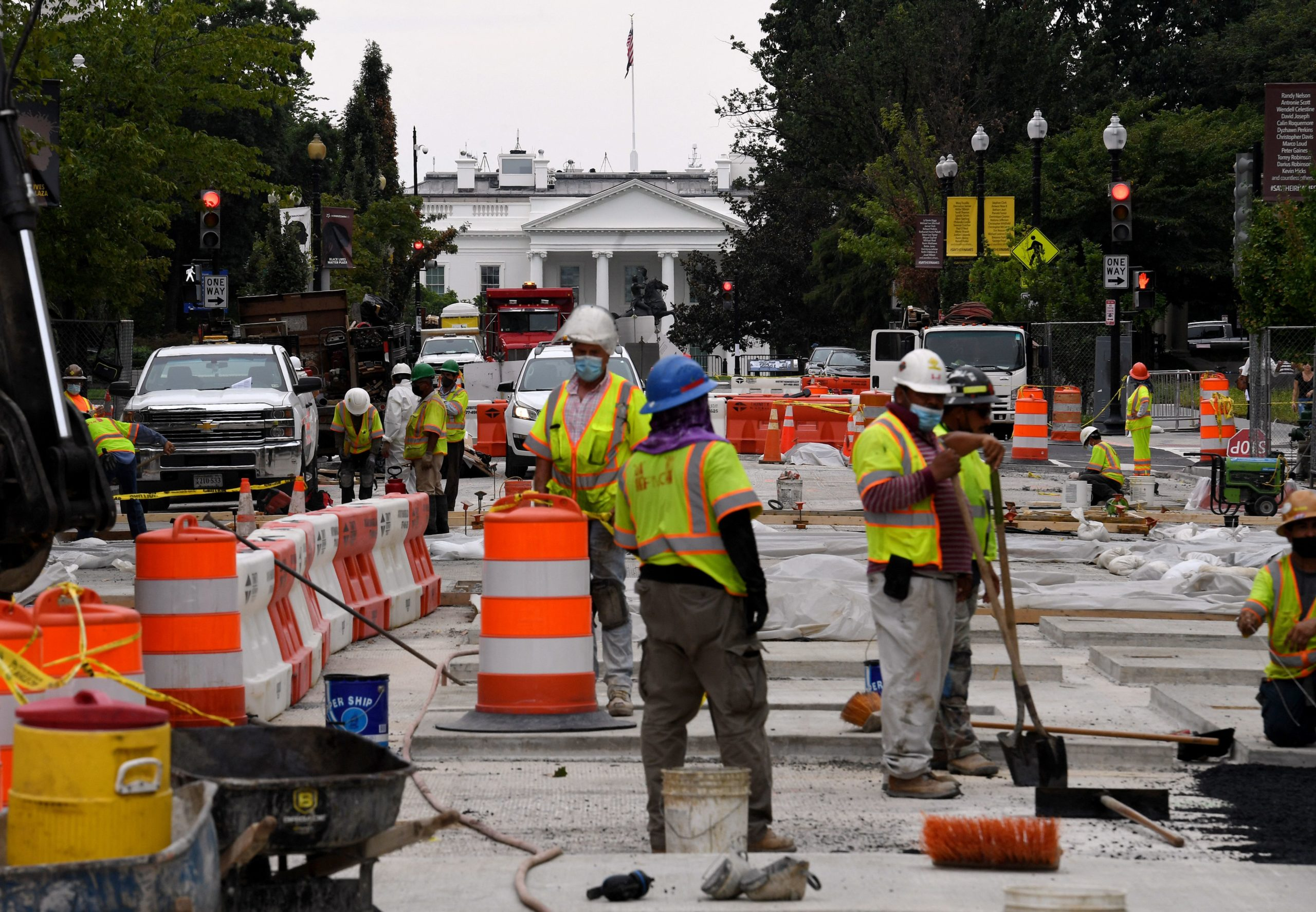 Construction workers repair a street near the White House in Washington, D.C. on Aug. 31. (Olivier Douliery/AFP via Getty Images)