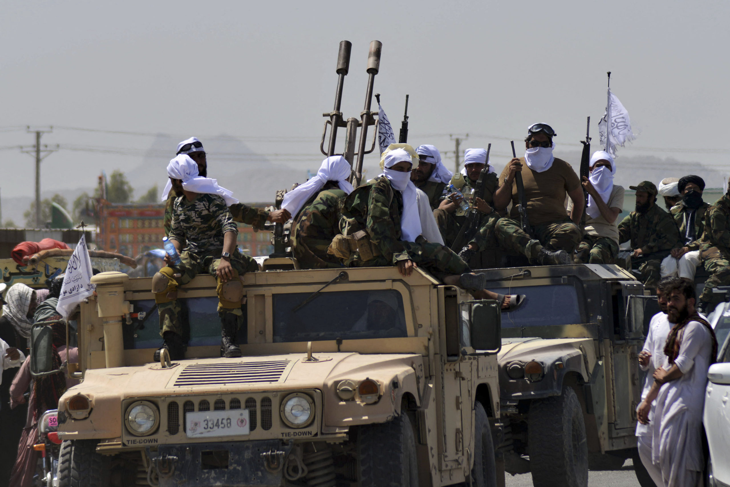 Taliban fighters ride U.S. Humvee vehicles during a parade in Kandahar, Afghanistan on Sept. 1. (Javed Tanveer/AFP via Getty Images)