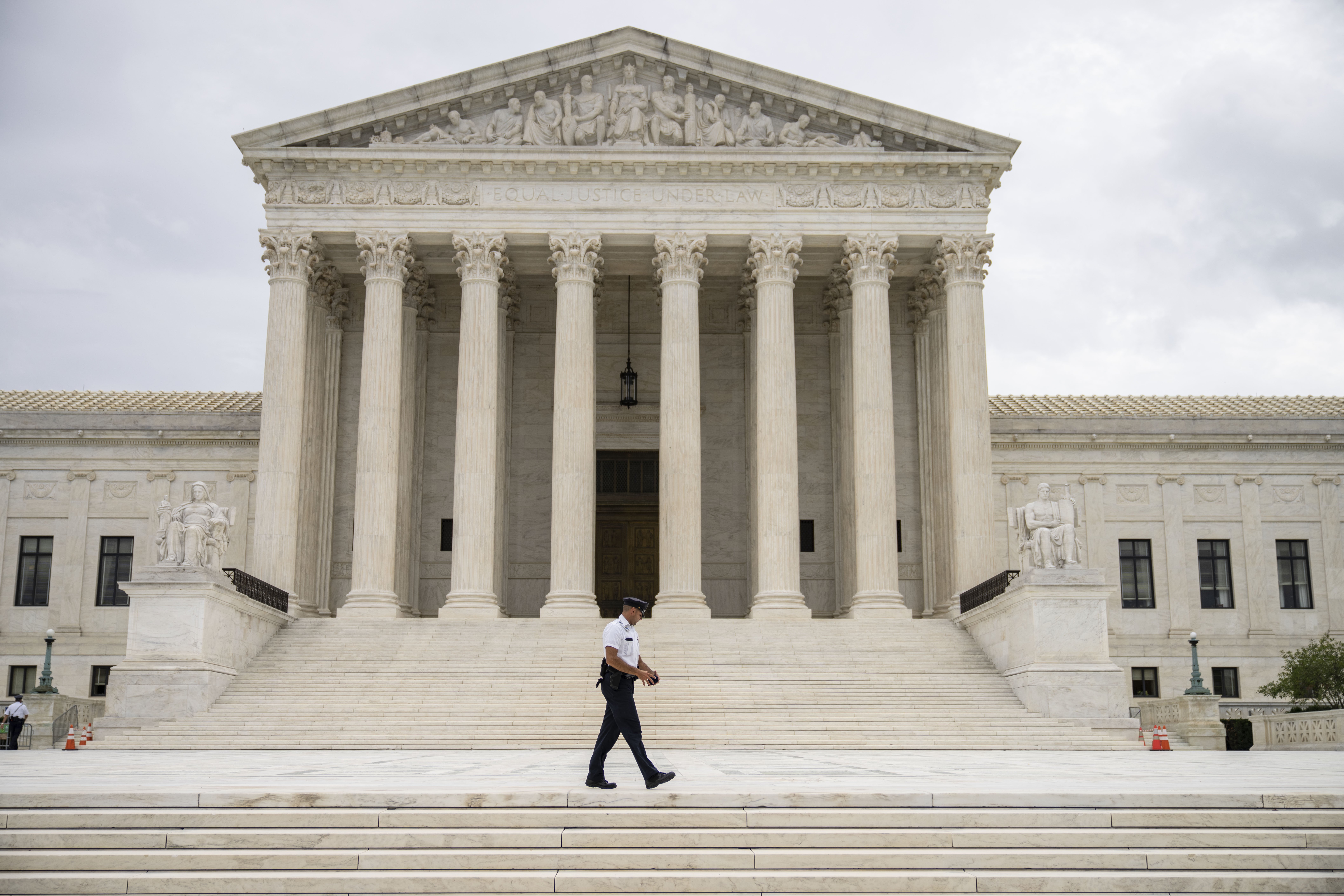 A Police officer patrols the Supreme Court Wednesday. (Drew Angerer/Getty Images)