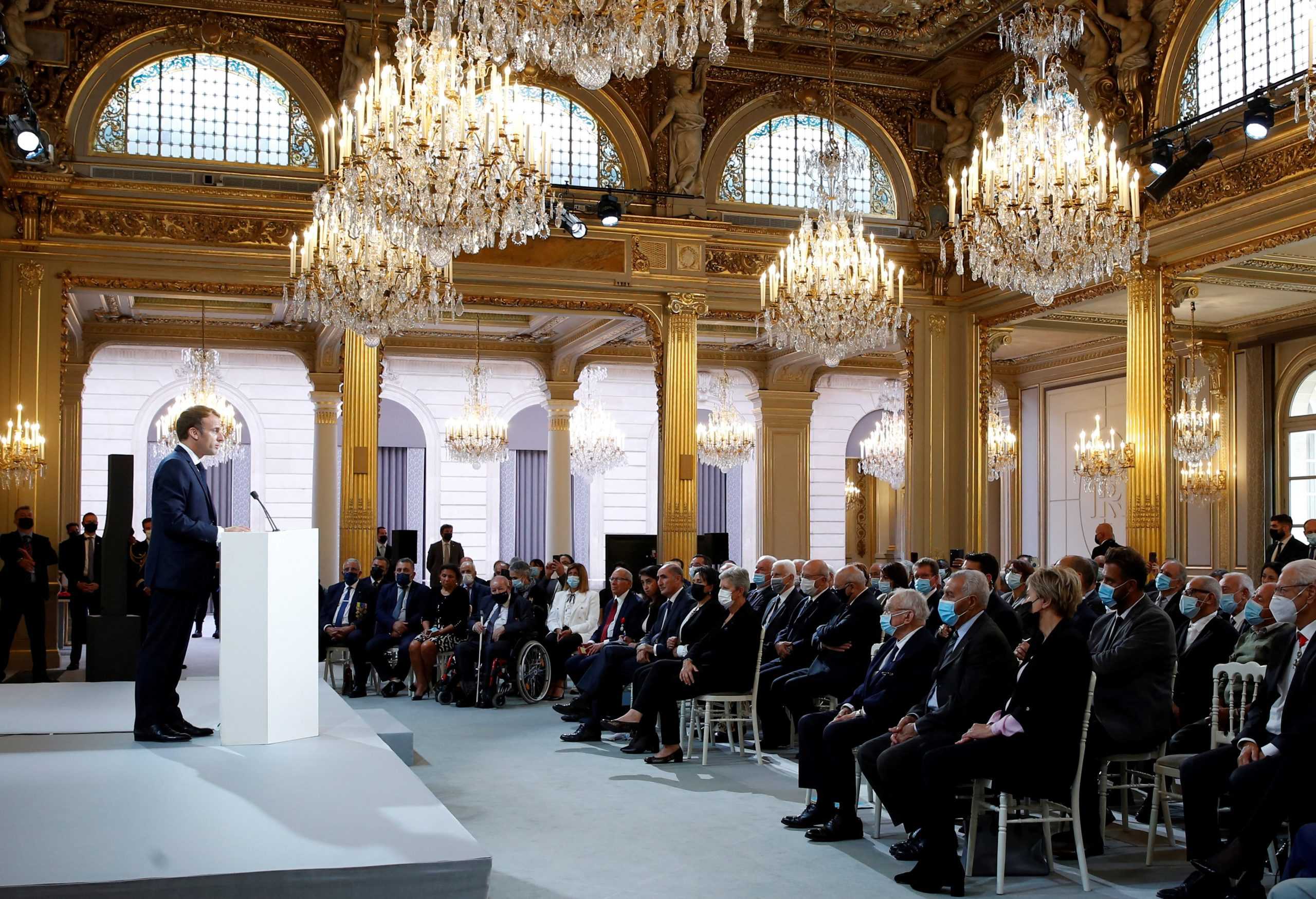 French president Emmanuel Macron delivers a speech during a ceremony in memory of the Harkis, Algerians who helped the French Army in the Algerian War of Independence, at the Elysee Palace in Paris, on September 20, 2021. (Photo by GONZALO FUENTES / POOL / AFP) (Photo by GONZALO FUENTES/POOL/AFP via Getty Images)