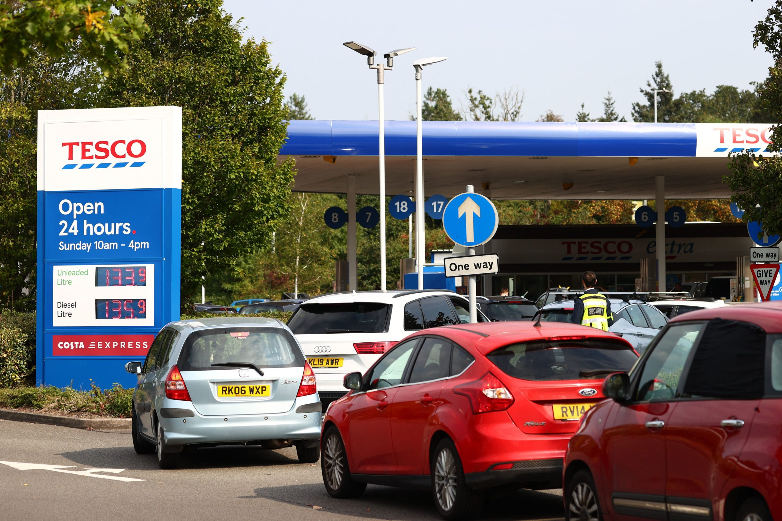 A line of vehicles is seen at a gas station in Camberley, U.K. on Sunday. (Adrian Dennis/AFP via Getty Images)