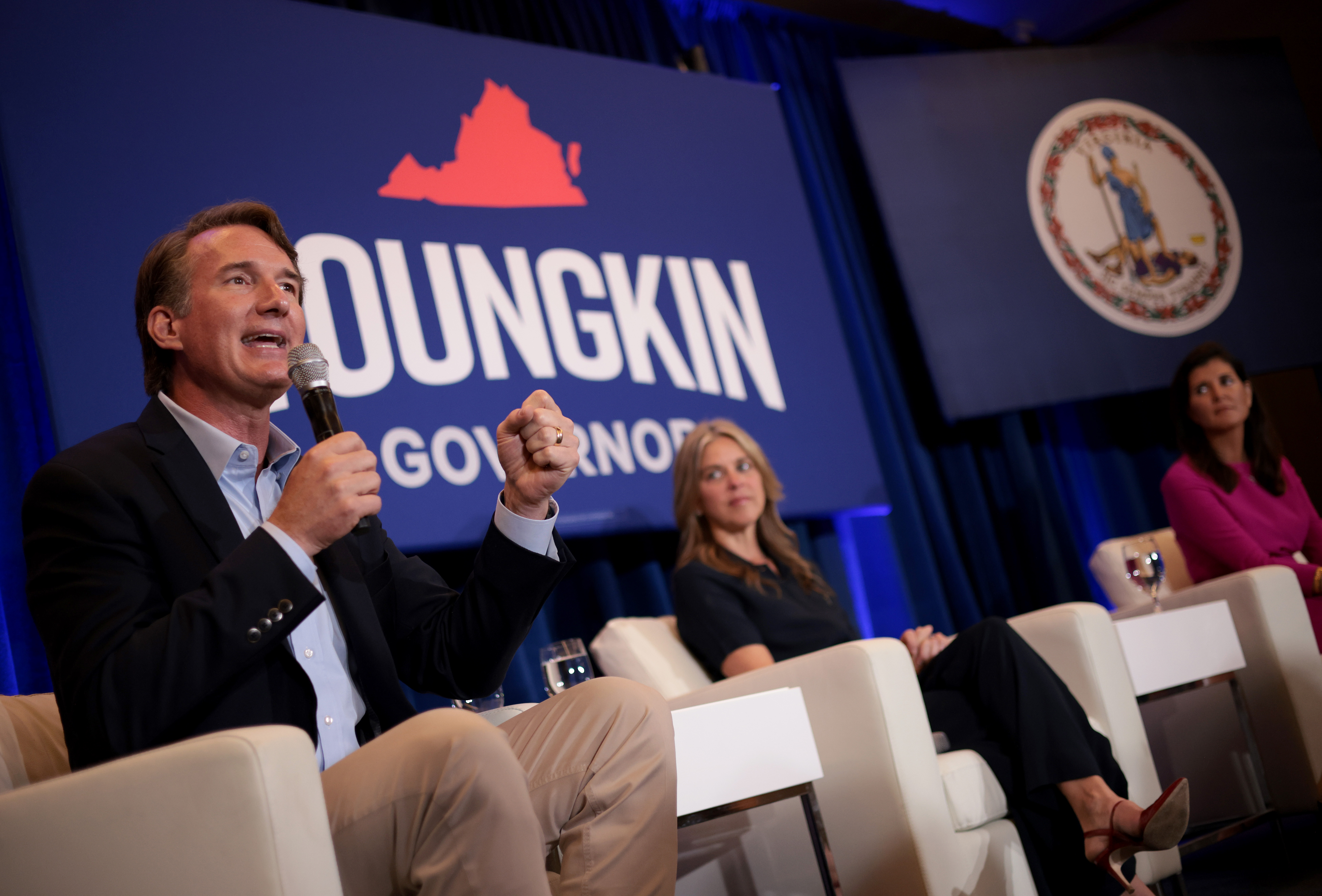 MCLEAN, VIRGINIA - JULY 14: Virginia gubernatorial candidate Glenn Youngkin (R-VA) speaks during a campaign event with his wife, Suzanne (C), and former South Carlina Gov. Nikki Haley (R) July 14, 2021 in McLean, Virginia. Youngkin is running against former Virginia Gov. Terry McAuliffe. (Photo by Win McNamee/Getty Images)