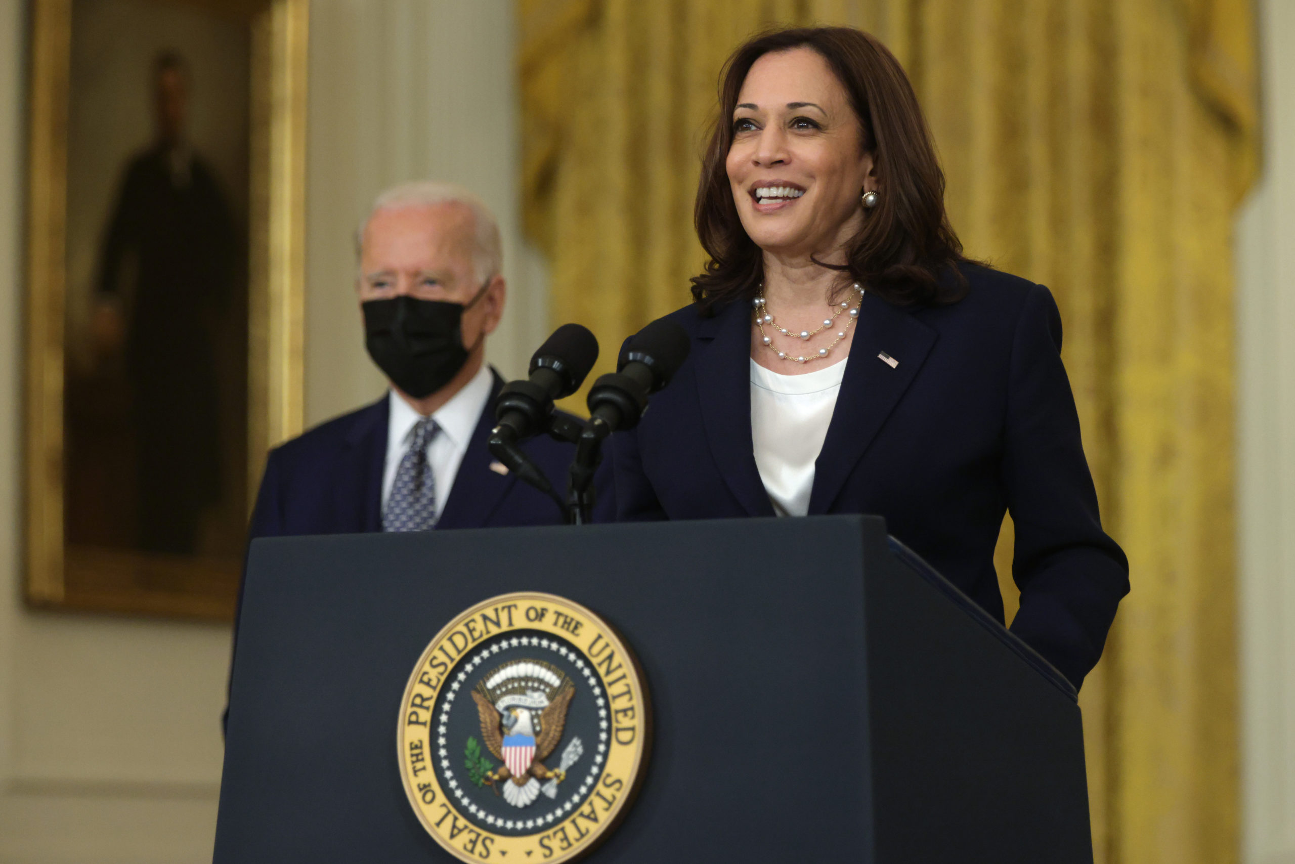 WASHINGTON, DC - AUGUST 10: U.S. Vice President Kamala Harris (R) speaks as President Joe Biden (L) listens during an event on Senate passage of the Infrastructure Investment and Jobs Act in the East Room of the White House August 10, 2021 in Washington, DC. The Senate has passed the bipartisan infrastructure bill with a vote of 69-30. (Photo by Alex Wong/Getty Images)