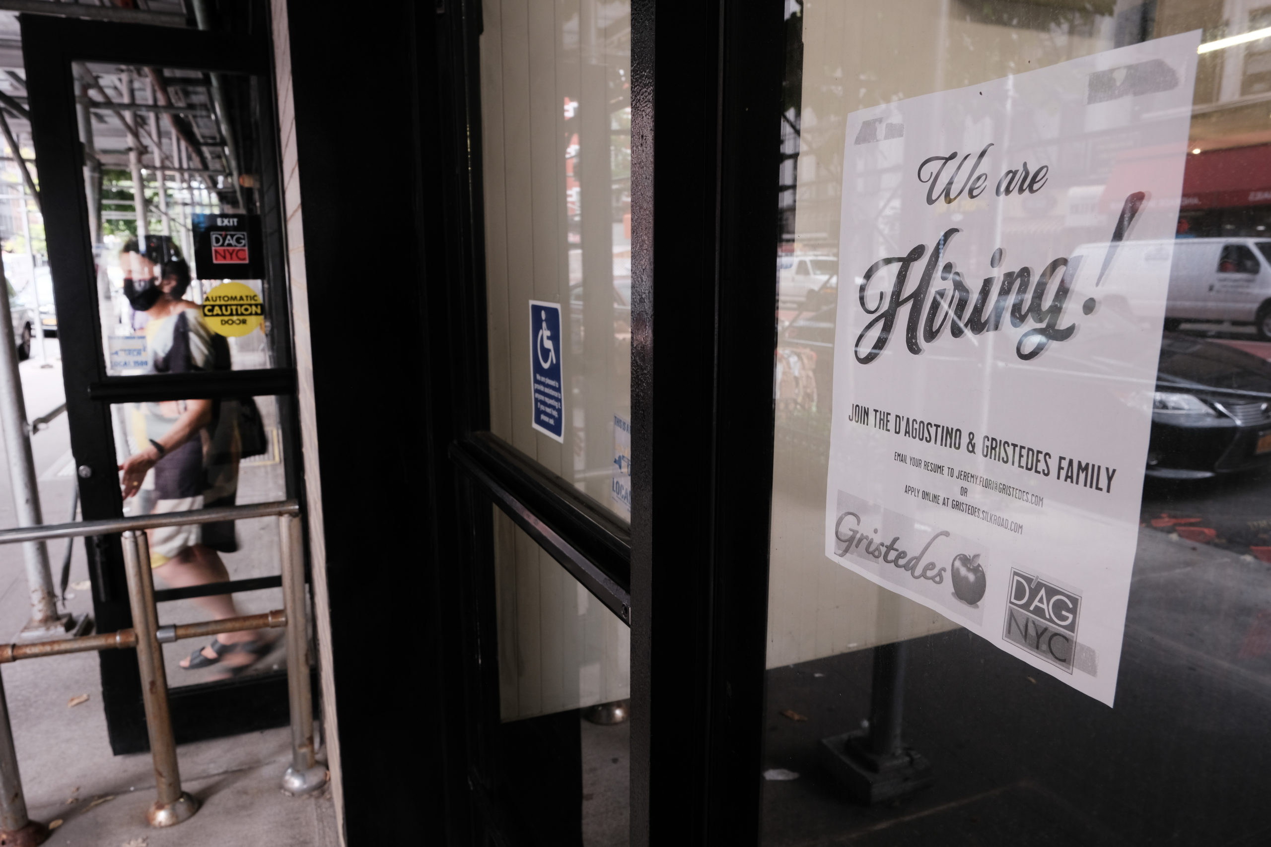 A hiring sign is displayed in a store window in New York City on Aug. 19. (Spencer Platt/Getty Images)