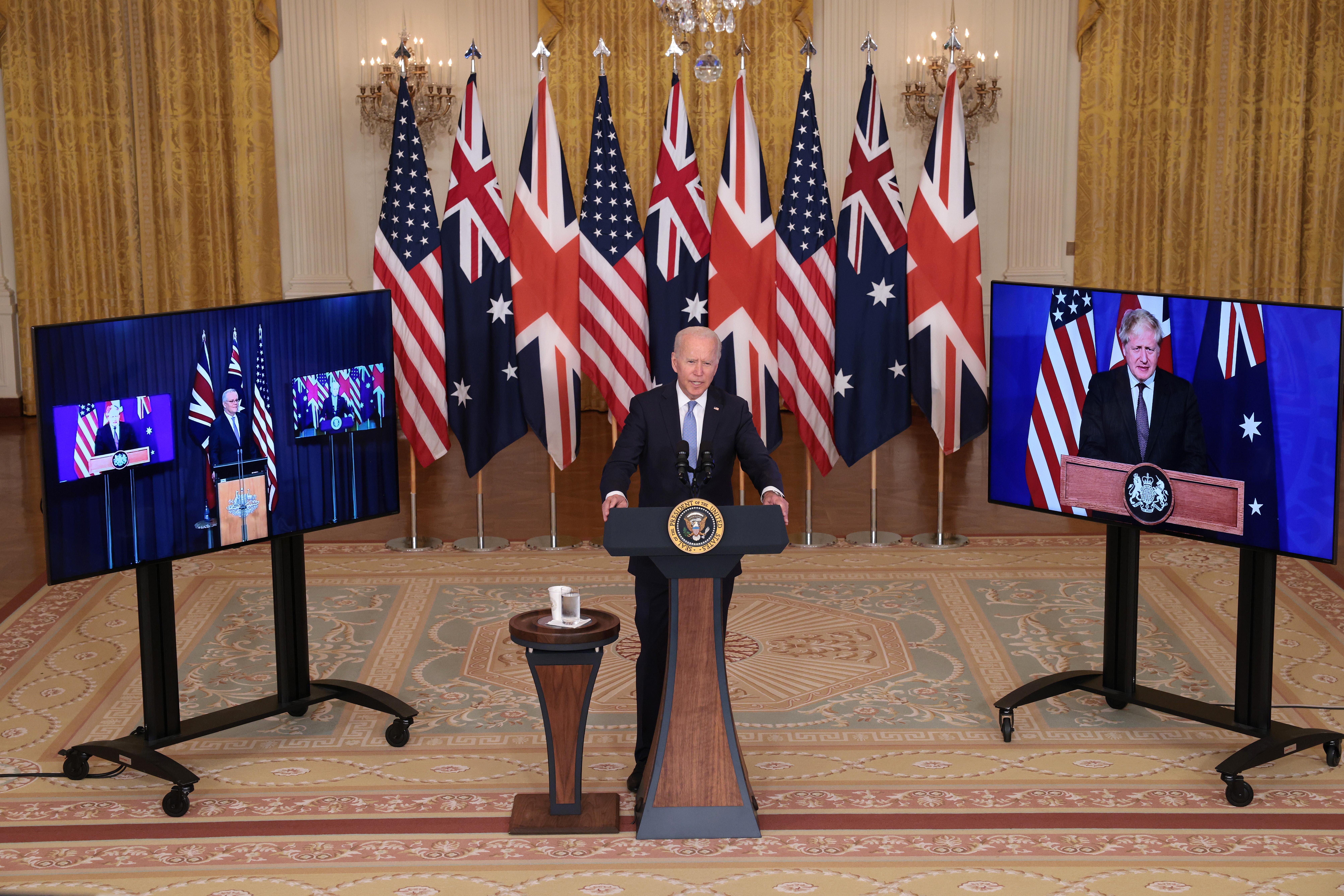 President Joe Biden speaks alongside Australian Prime Minister Scott Morrison and United Kingdom Prime Minister Boris Johnson Wednesday. (Win McNamee/Getty Images)