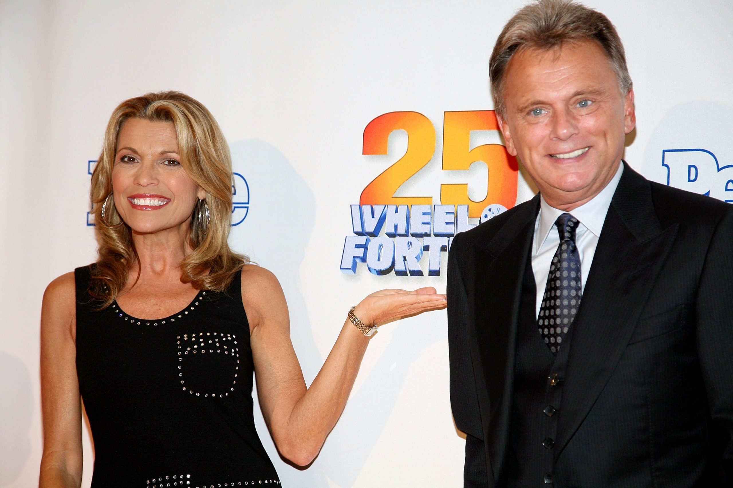 """NEW YORK - SEPTEMBER 27: (R) Host of the TV game show """"Wheel Of Fortune"""" Pat Sajak and model Vanna White attend the 25th anniversary celebration of the television game show """"Wheel Of Fortune"""" at Radio City Music Hall September 27, 2007 in New York City. (Photo by Astrid Stawiarz/Getty Images)"""
