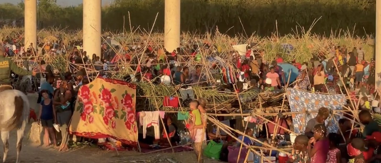 Mostly Haitian Migrants Camp Under Del Rio International Bridge. [Screenshot/Twitter/Bill Melugin]