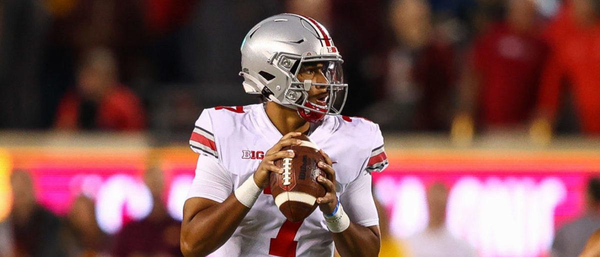 Ohio State Buckeyes quarterback J. T. Barrett stands in