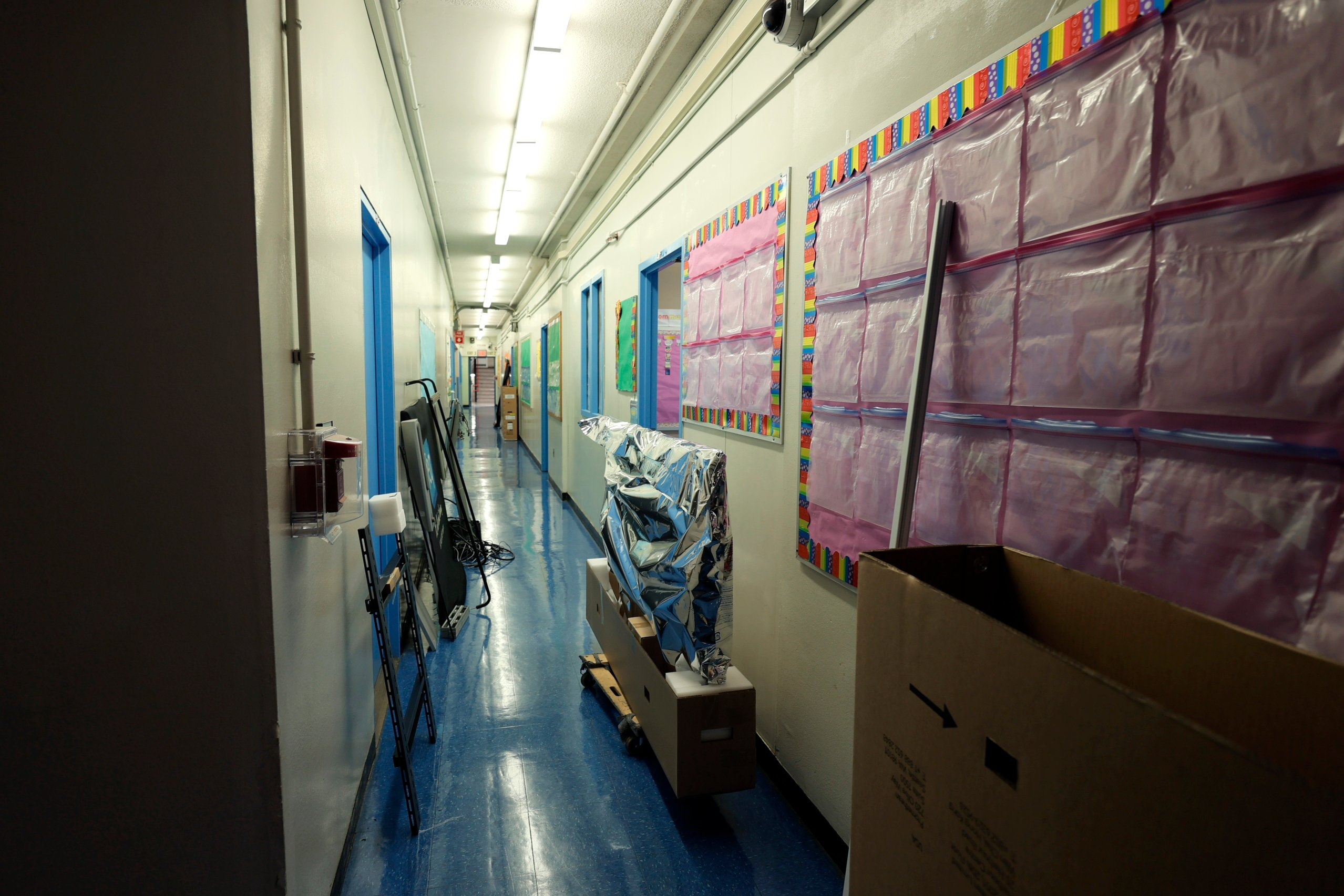 A hallway at Yung Wing School P.S. 124 is filled with classroom items for the start of the school year on September 02, 2021 in New York City. (Photo by Michael Loccisano/Getty Images)
