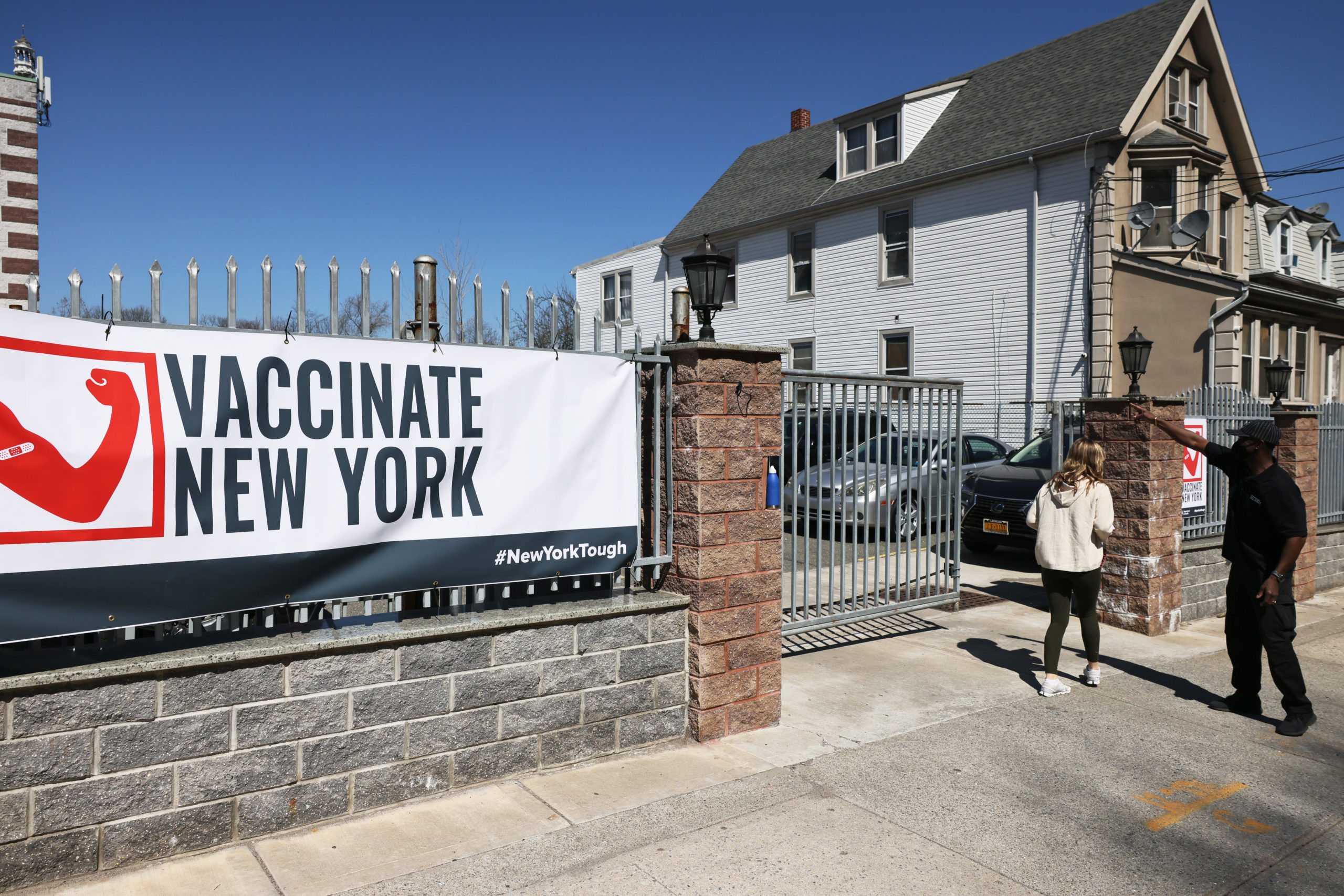 A security guard gives directions to enter the Northwell Health pop-up coronavirus (COVID-19) vaccination site at the Albanian Islamic Cultural Center in Staten Island on April 08, 2021 in New York City. NYC continues to have a 6.55 percent coronavirus (COVID-19) cases on a seven-day rolling average as the city continues to ramp up vaccinations. The city last week set a record of 524,520 coronavirus (COVID-19) vaccinations. (Photo by Michael M. Santiago/Getty Images)