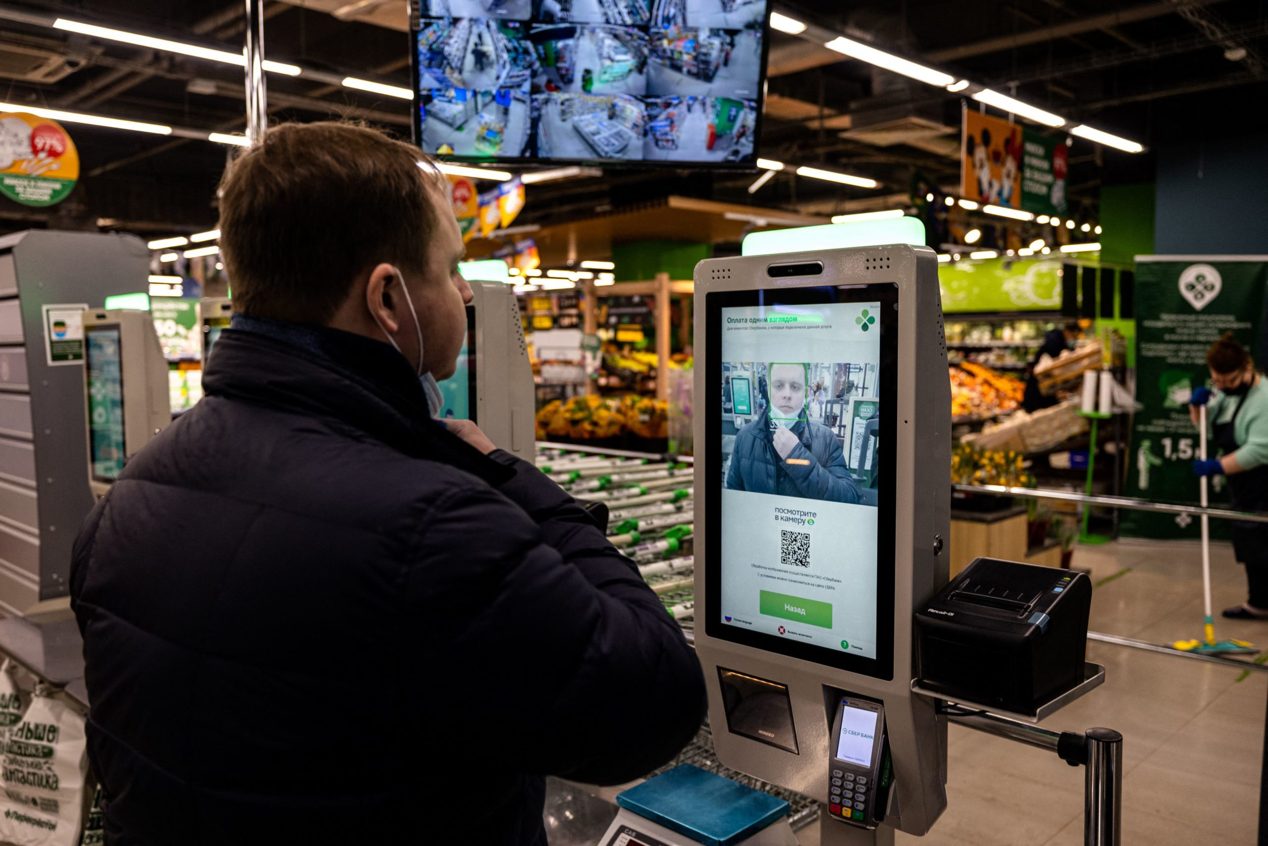 An X5 group representative demonstrates a facial recognition payment system at a self-checkout machine in a Perekrestok supermarket in Moscow on March 9, 2021. (Photo by DIMITAR DILKOFF/AFP via Getty Images)