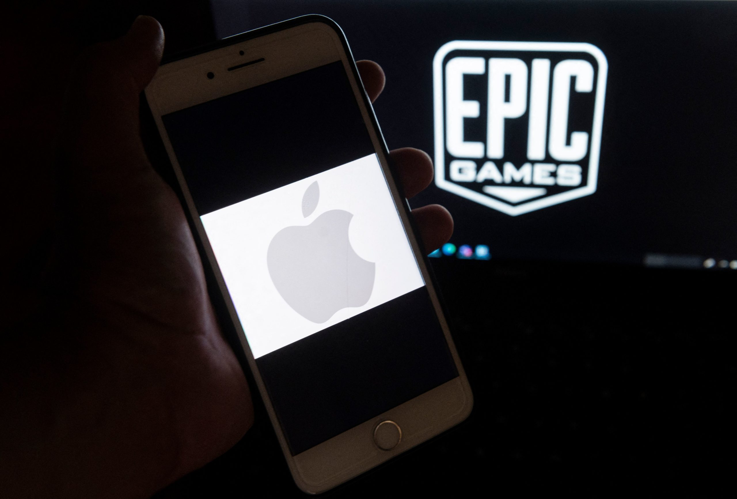 This illustration picture shows the logo from Epic Games displayed on a laptop and an Apple Logo on an iPhone in Arlington, Virginia on April 30, 2021. (Photo by ANDREW CABALLERO-REYNOLDS/AFP via Getty Images)