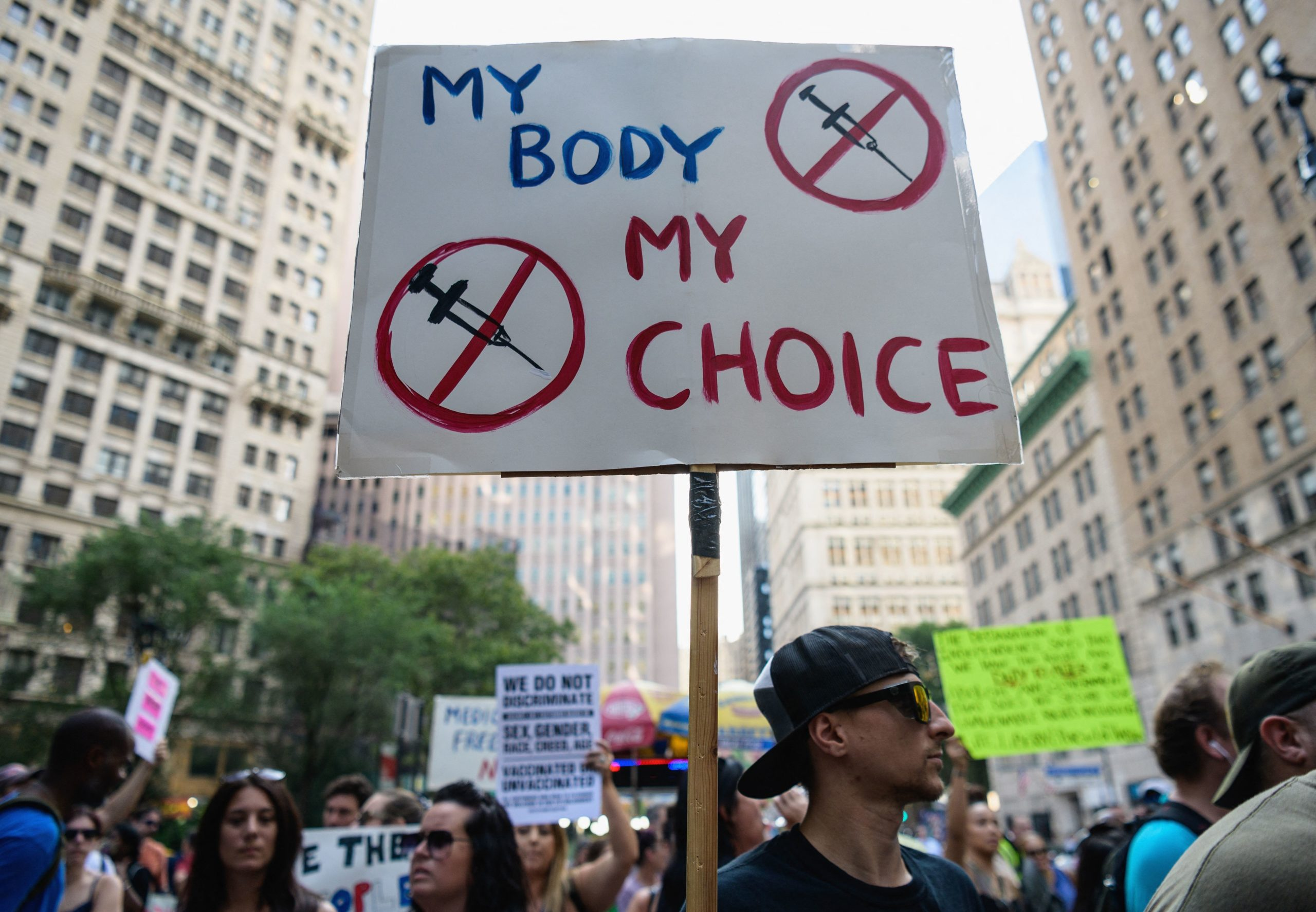 TOPSHOT - Protestors opposed to Covid-19 vaccine mandates and vaccine passports by the government rally at City Hall in New York City on August 25, 2021. (Photo by Angela WEISS / AFP) (Photo by ANGELA WEISS/AFP via Getty Images)