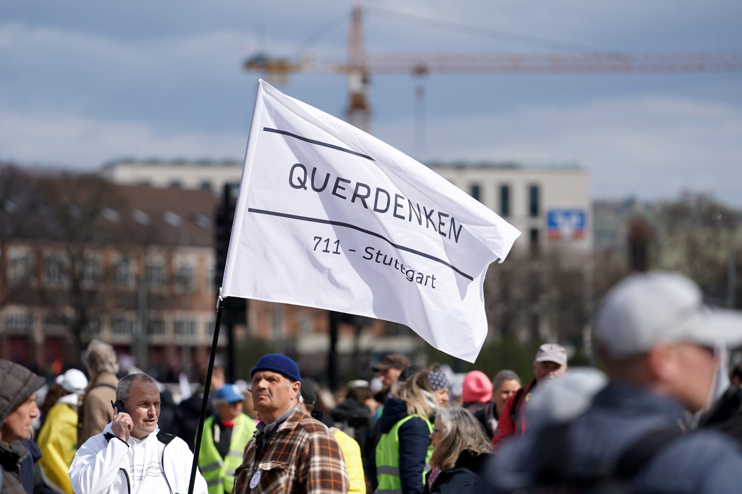 """Supporters of the Querdenken movement march for what they claim are their basic rights during the third wave of the coronavirus pandemic on April 03, 2021 in Stuttgart, Germany. Querdenken, which means """"lateral thinking"""" is Germany's biggest movement that to protest against coronavirus-related lockdown measures. (Photo by Thomas Niedermueller/Getty Images)"""