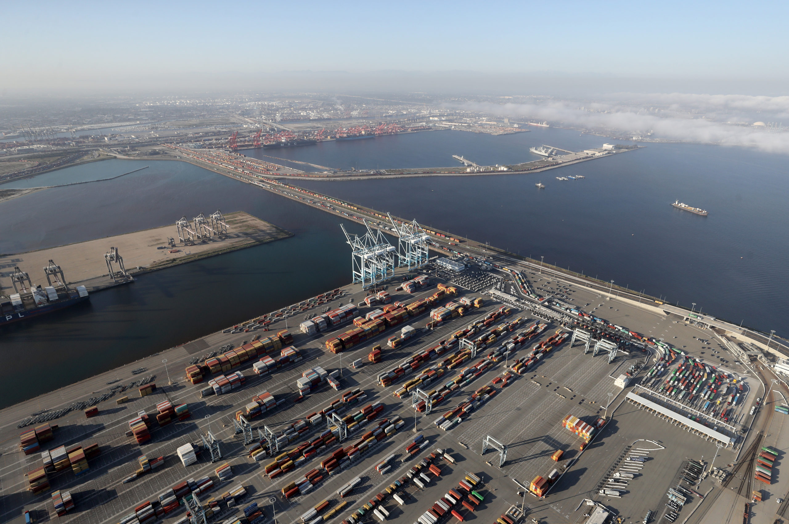 SAN PEDRO, CALIFORNIA - APRIL 28: An aerial view of the Port of Los Angeles and Port of Long Beach amid the coronavirus pandemic on April 28, 2020 in San Pedro, California. Around three dozen oil tankers are currently anchored off the California coast, with around twenty anchored off the ports of Los Angeles and Long Beach, as the spread of COVID-19 impacts global demand for crude oil. (Photo by Mario Tama/Getty Images)