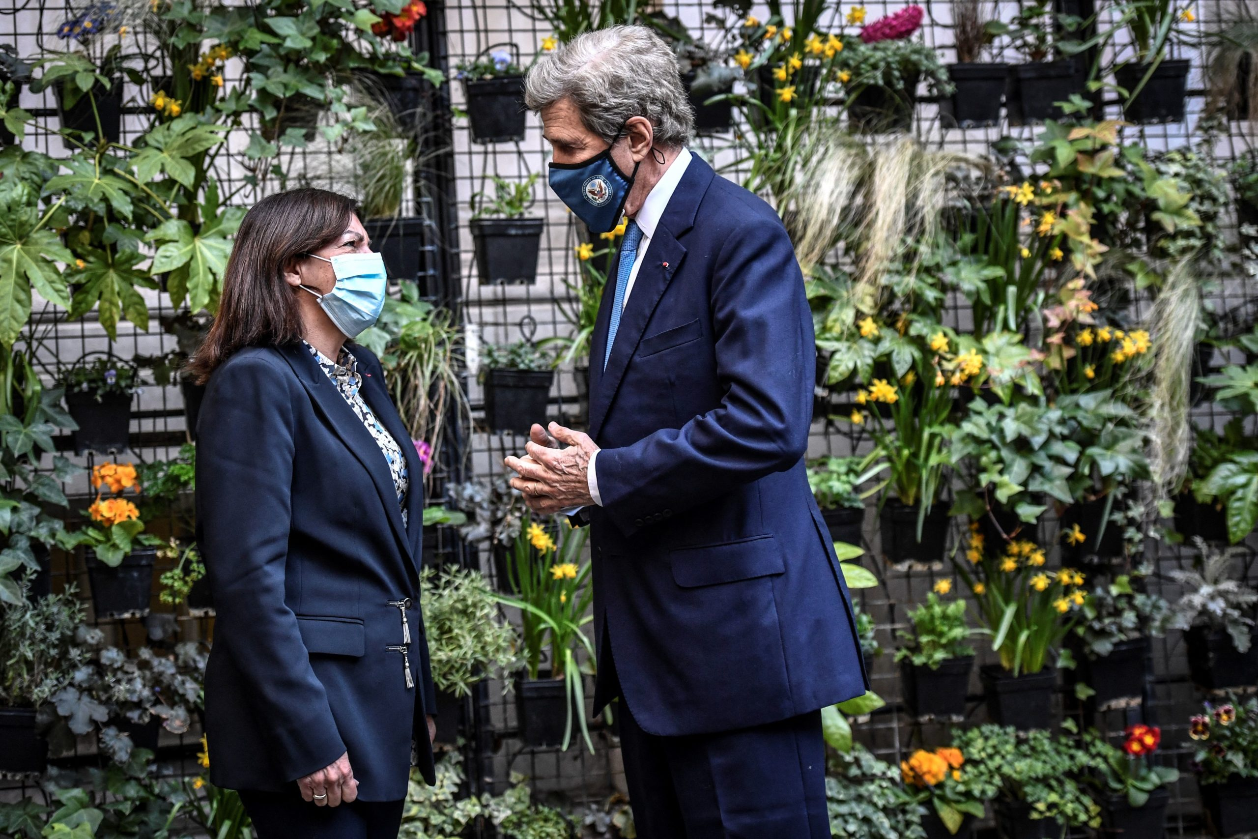 U.S. climate envoy John Kerry speaks withe the mayor of Paris prior to their meeting on March 12. (Stephane de Sakutin/AFP via Getty Images)