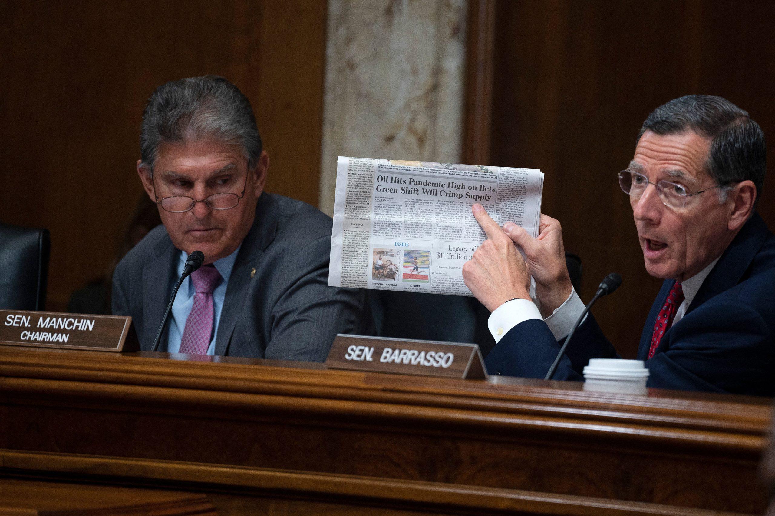 Senate Energy Committee Chairman Joe Manchin looks on as Ranking Member John Barrasso speaks during a hearing on June 15. (Jim Watson/AFP via Getty Images)