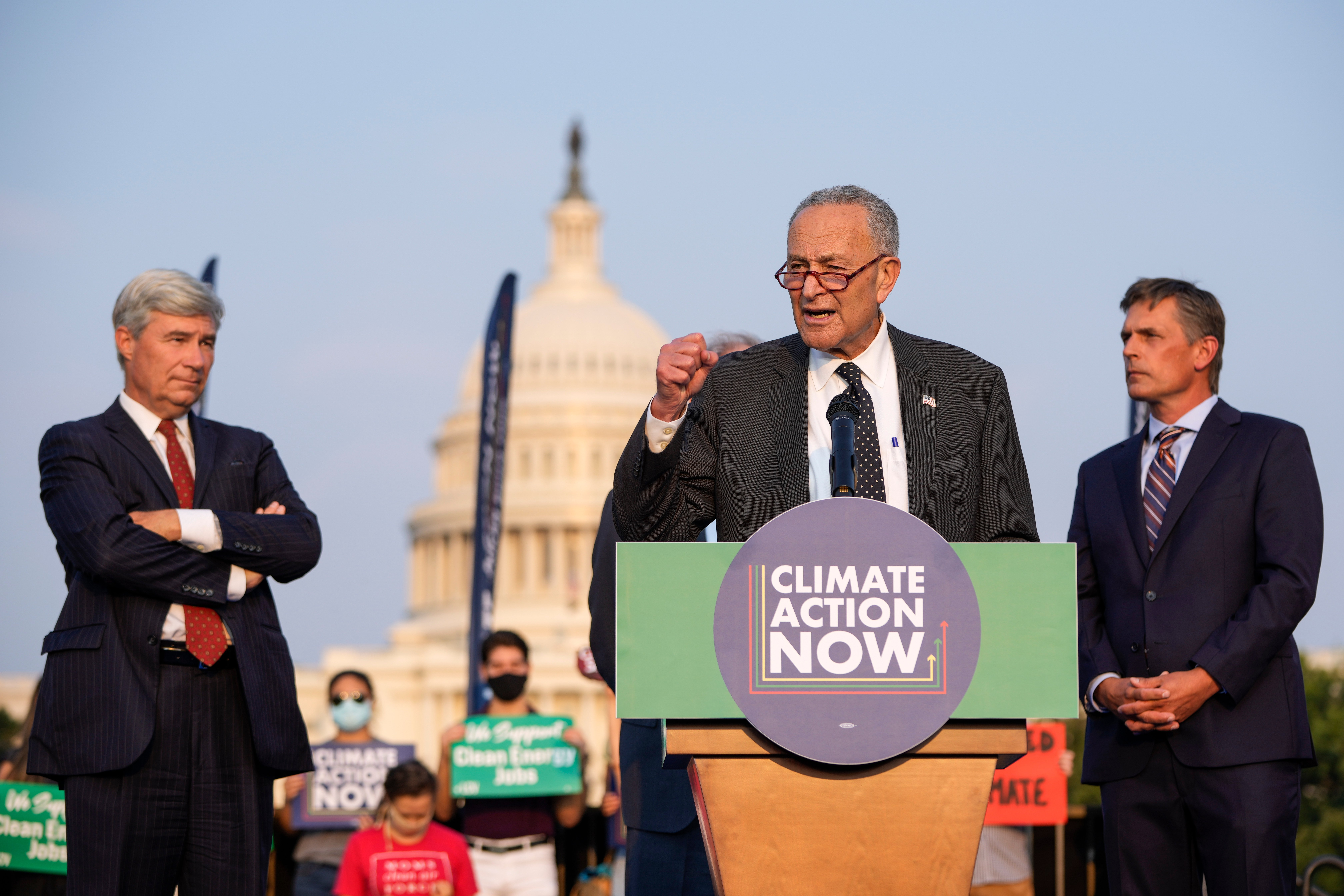 Senate Majority Leader Chuck Schumer speaks during a rally about climate change issues near the U.S. Capitol on Sept. 13. (Drew Angerer/Getty Images)