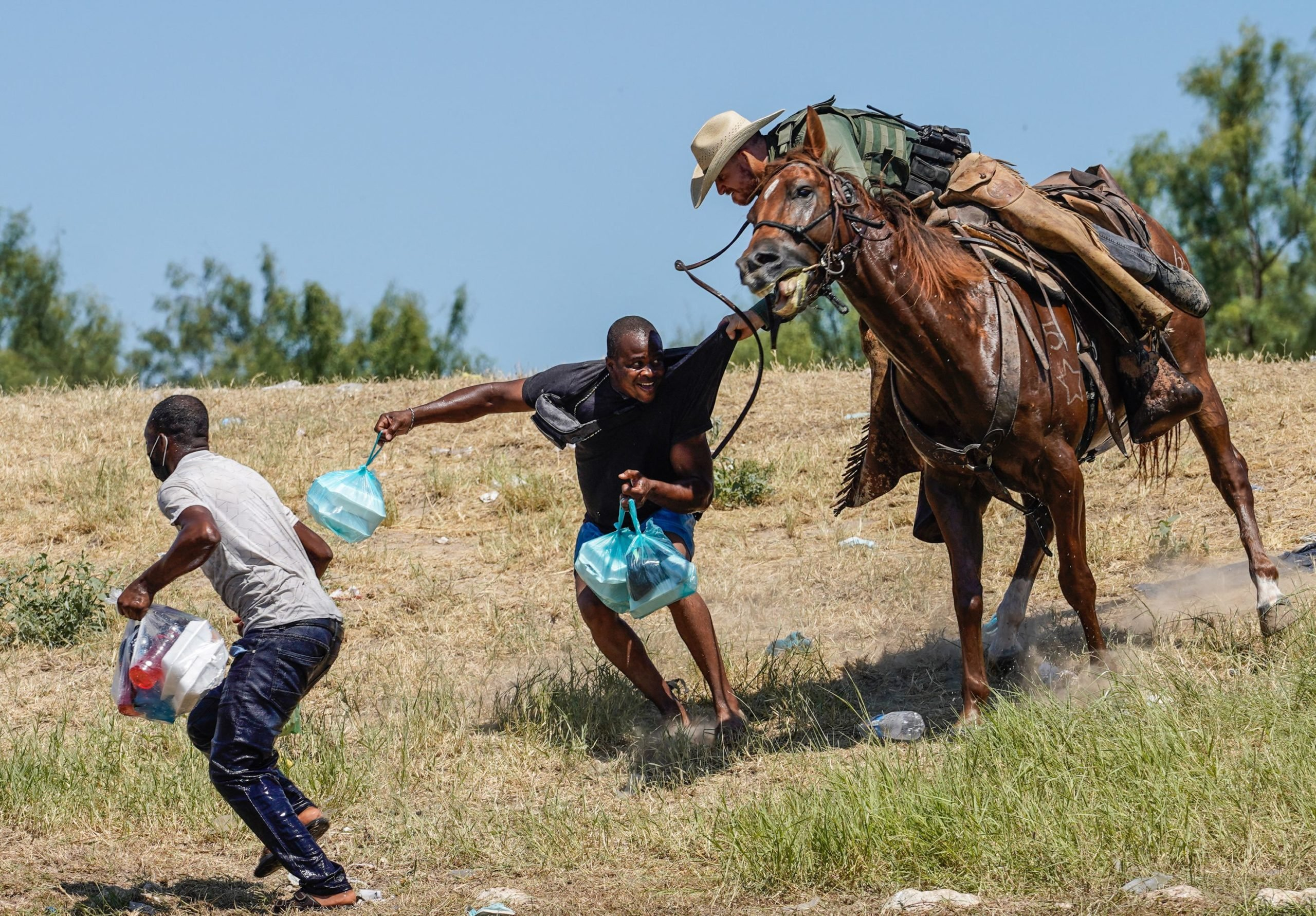 A United States Border Patrol agent on horseback tries to stop a Haitian migrant from entering an encampment on the banks of the Rio Grande near the Acuna Del Rio International Bridge in Del Rio, Texas on September 19, 2021. (Photo by PAUL RATJE/AFP via Getty Images)