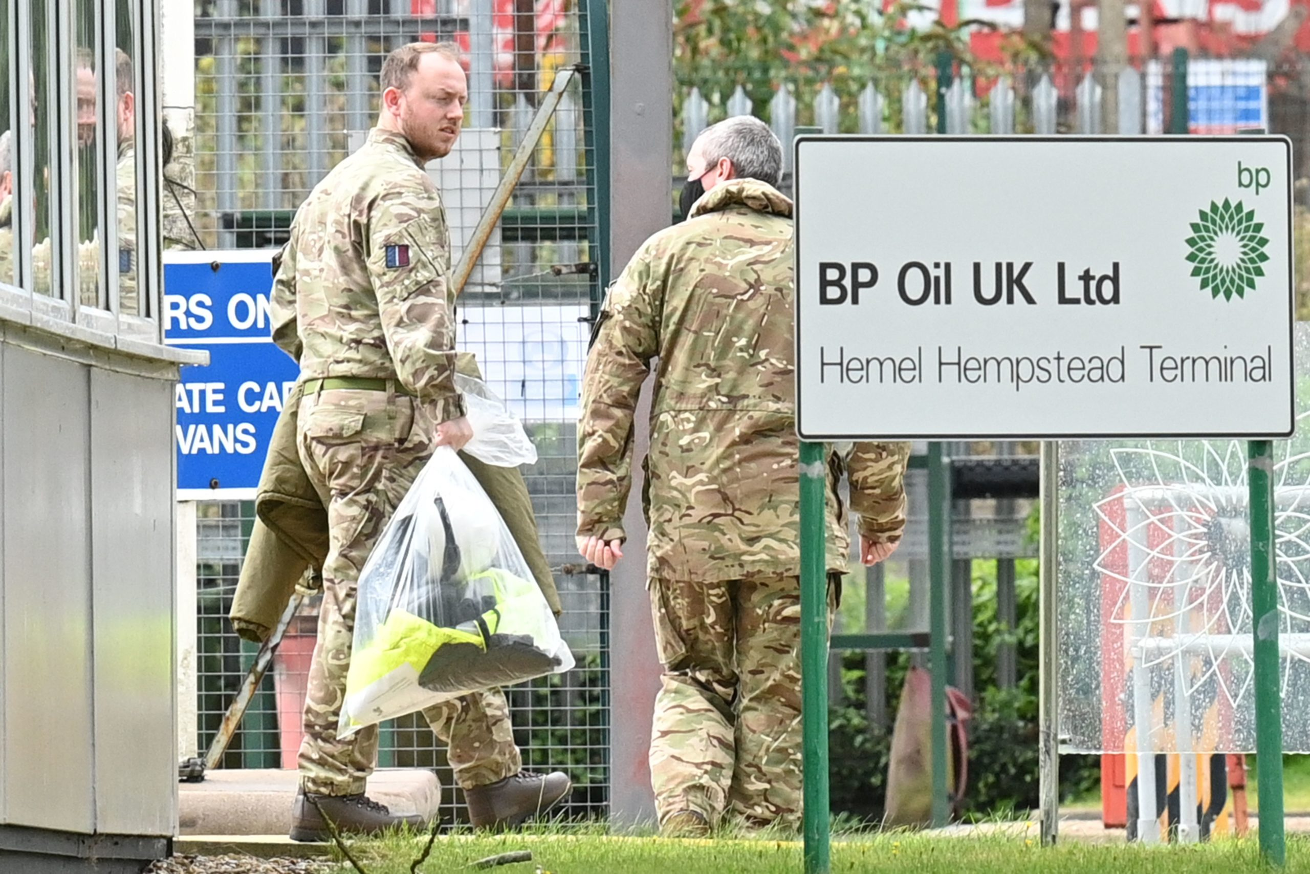 Members of the U.K. Armed Forces walk near the oil depot located in north London on Tuesday. (Justin Tallis/AFP via Getty Images)