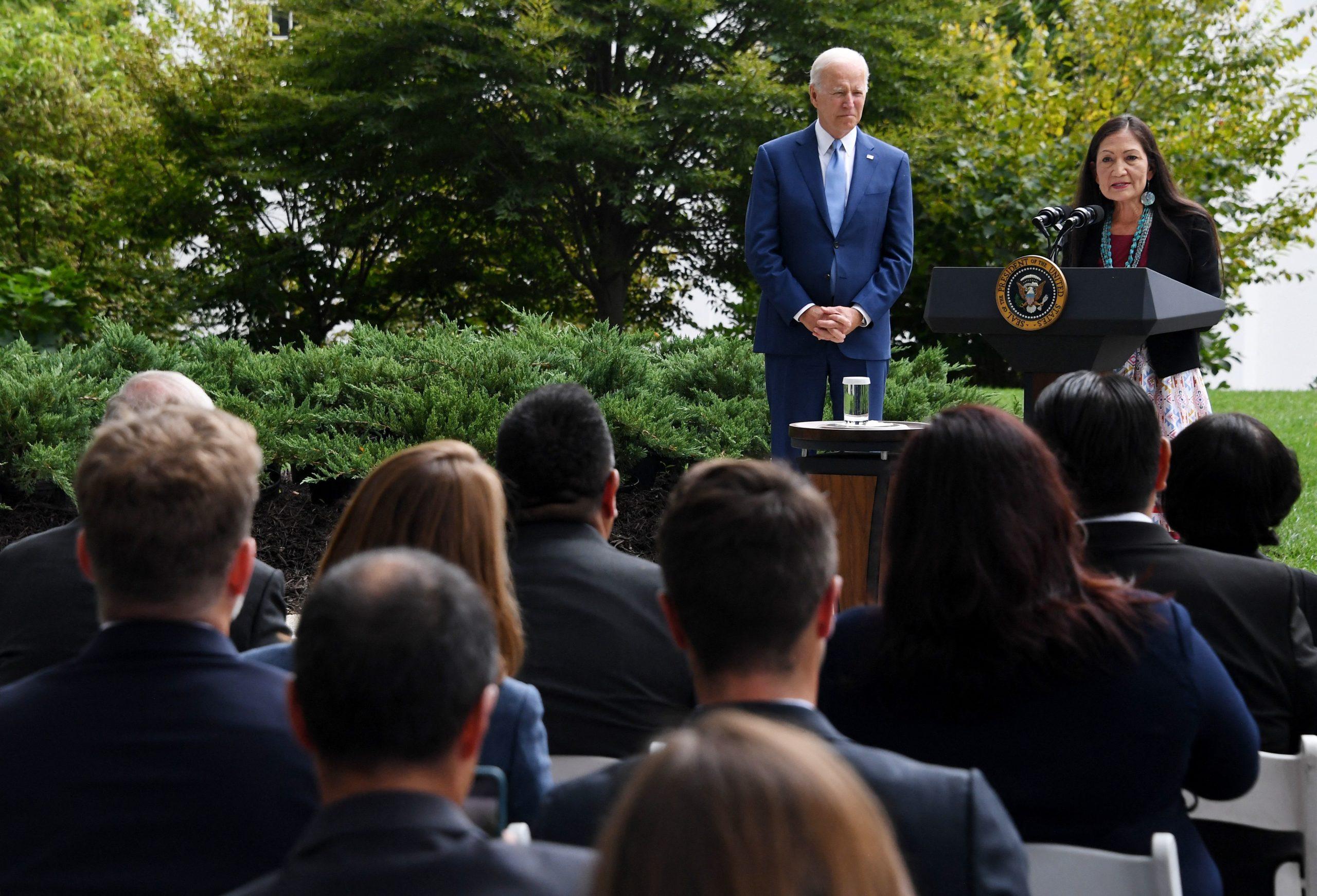 President Joe Biden listens to Interior Secretary Deb Haaland speak during a ceremony on Oct. 8. (Olivier Douliery/AFP via Getty Images)