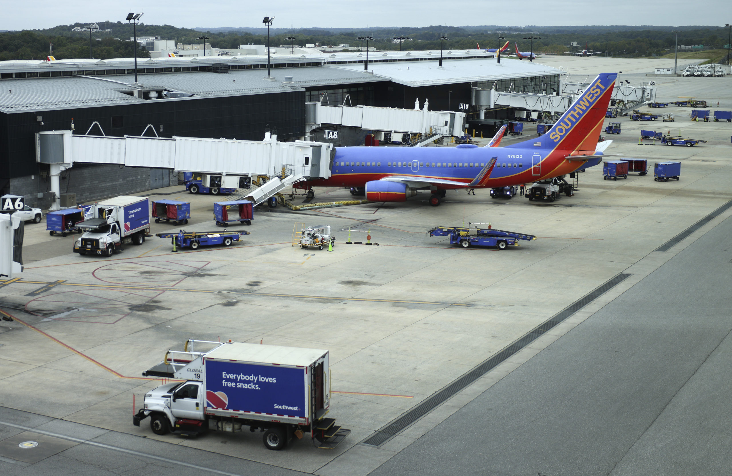 BALTIMORE, MARYLAND - OCTOBER 11: A Southwest Airlines airplane waits at a gate at Baltimore Washington International Thurgood Marshall Airport on October 11, 2021 in Baltimore, Maryland. Southwest Airlines is working to catch up on a backlog after canceling hundreds of flights over the weekend, blaming air traffic control issues and weather. (Photo by Kevin Dietsch/Getty Images)