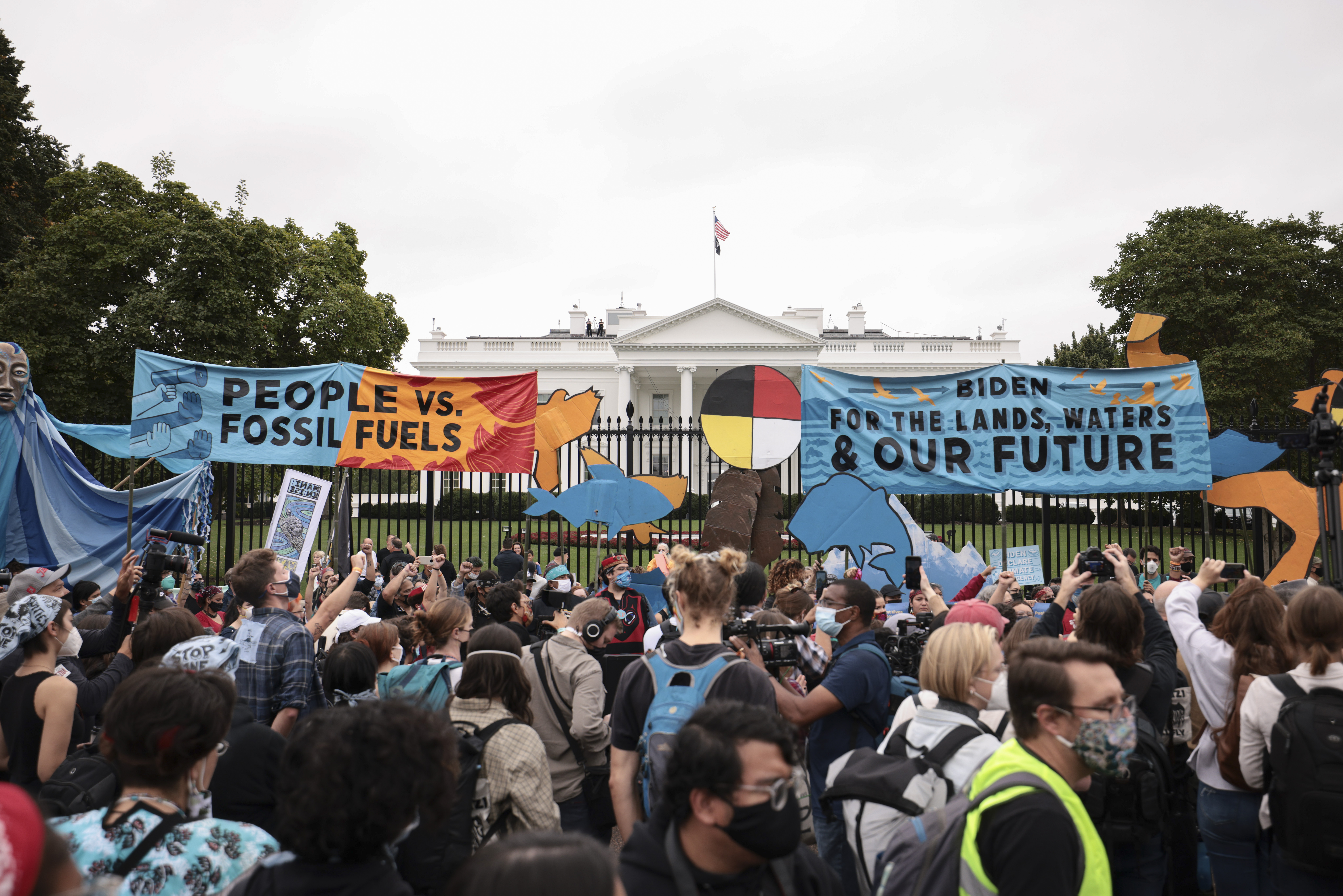 Demonstrators stand in front of the White House during a climate march on Monday in Washington, D.C. (Anna Moneymaker/Getty Images)