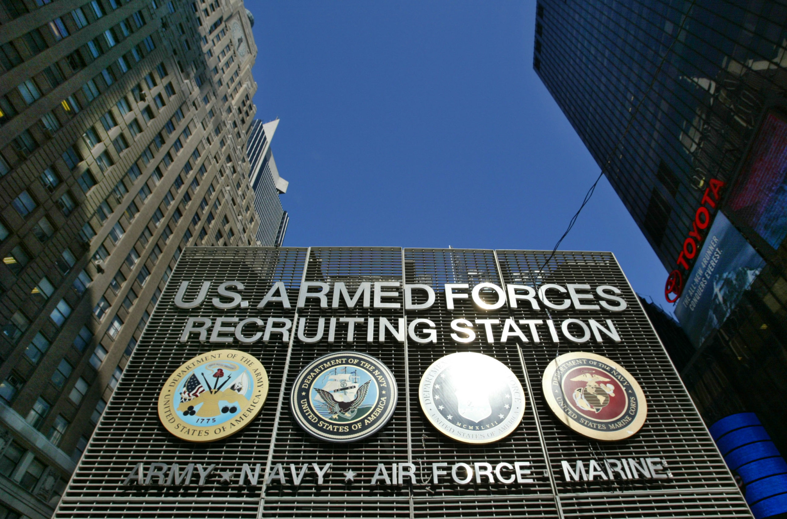 The U.S. Armed Forces Recruiting Station in Times Square sits nestled among skycrapers February 20, 2003 in New York City. (Photo by Chris Hondros/Getty Images)