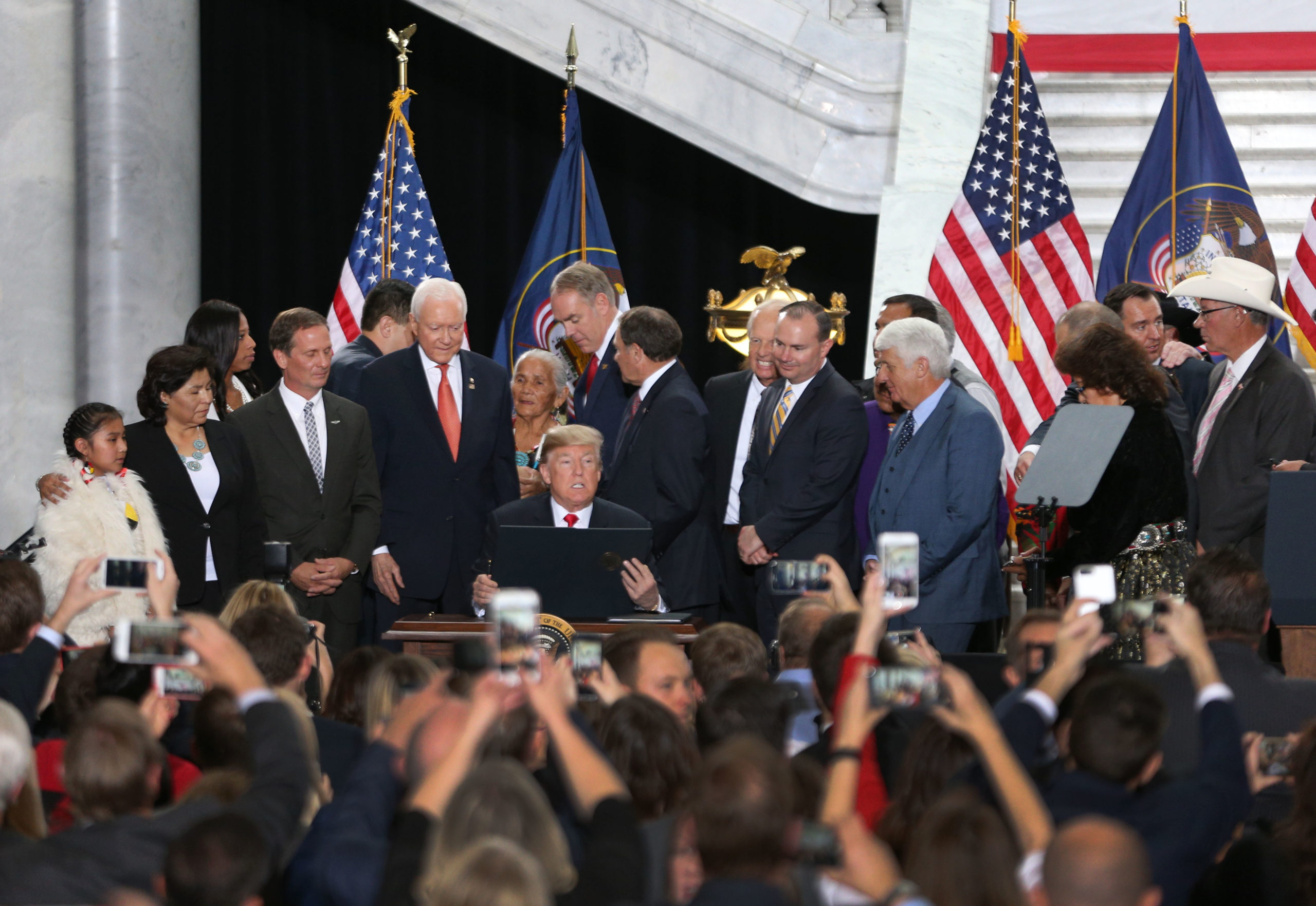 With Utah officials surrounding him, President Donald Trump reads an executive order he signed reducing monuments on Dec. 4, 2017 in Salt Lake City, Utah. (George Frey/Getty Images)