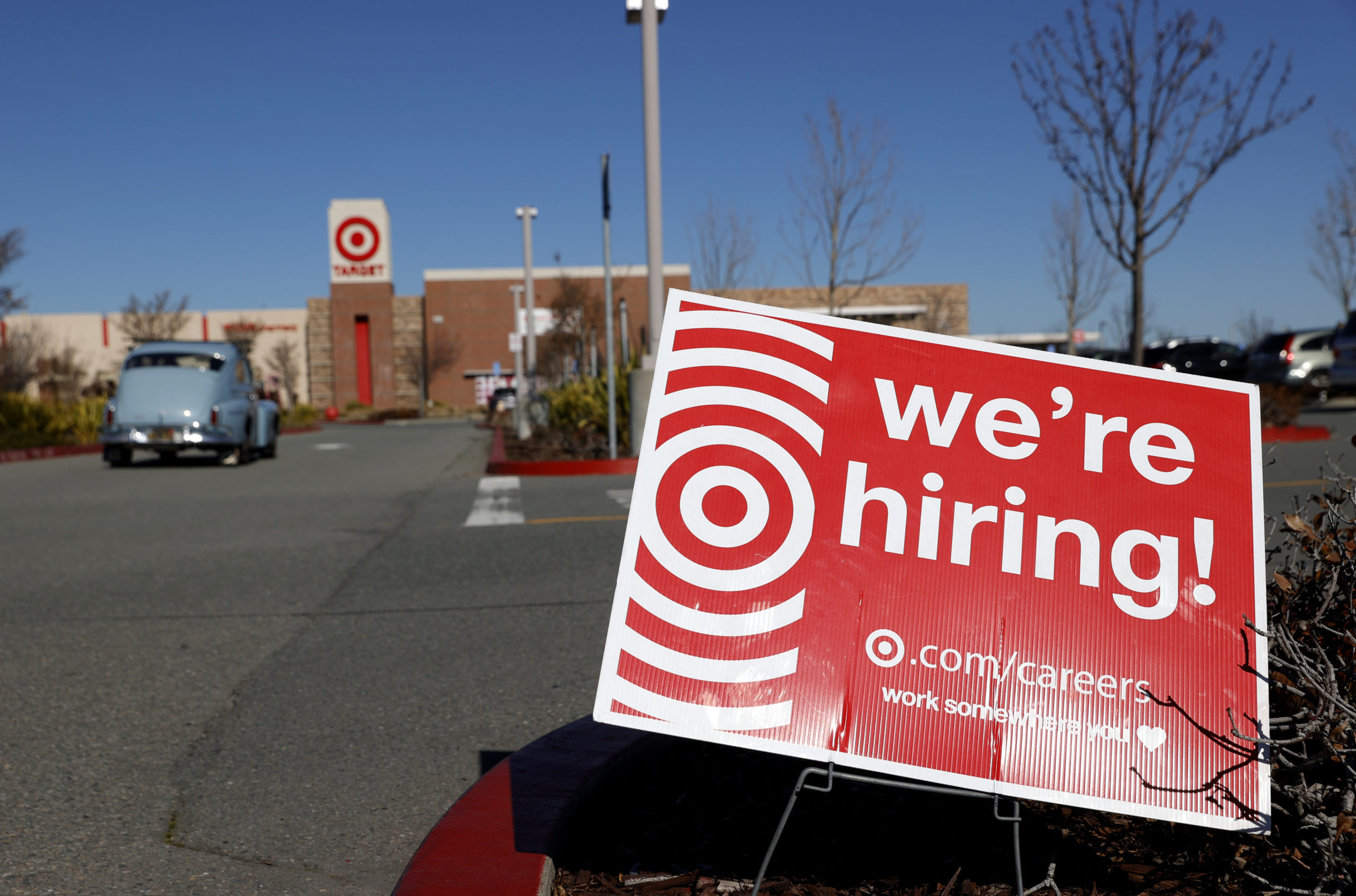 A hiring sign is posted in front of a Target store on February 05, 2021 in San Rafael, California. (Photo by Justin Sullivan/Getty Images)