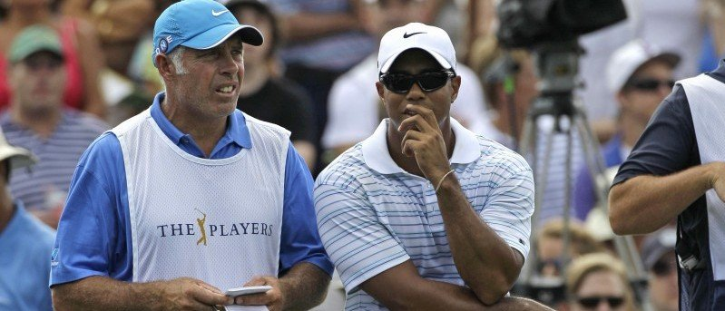 Tiger Woods and his caddie, Steve Williams, wait to hit from the third tee during the third round of The Players Championship golf tournament Saturday, May 8, 2010, in Ponte Vedra Beach, Fla. (AP Photo/Rob Carr)