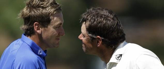 Ian Poulter, left, of England and Lee Westwood of England shake hands on the 17th green during a practice round at the Masters golf tournament in Augusta, Ga., Tuesday, April 6, 2010. The tournament begins Thursday, April, 8. (AP Photo/Rob Carr)