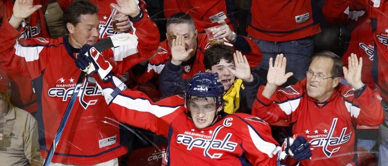 Washington Capitals' Alex Ovechkin, center foreground, reacts after scoring his 50th goal of the season against the Atlanta Thrashers during the third period of an NHL hockey game Friday, April 9, 2010, in Washington. The Capitals won 5-2. (AP Photo/Luis M. Alvarez)