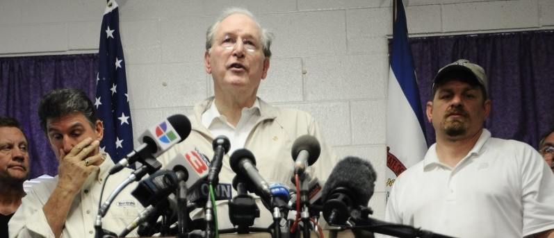 U.S. Sen. Jay Rockefeller, D-W.V., center, speaks to reporters as West Virginia Gov. Joe Manchin, left and Chris Adkins COO of Massey's Upper Big Branch mine look on Monday, April 6, 2009 in Montcoal, W.Va. The blast Monday at Massey's Upper Big Branch mine _ the nation's deadliest mining disaster since at least 1984 _ was believed to have been caused by a buildup of highly combustible methane. (AP Photo/Jeff Gentner)