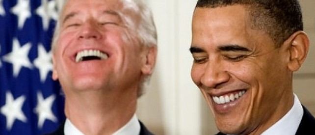 President Barack Obama laughs alongside Vice President Joe Biden prior to signing the health-care reform legislation during a ceremony in the East Room of the White House in Washington, DC, March 23, 2010. (SAUL LOEB/AFP/Getty Images)