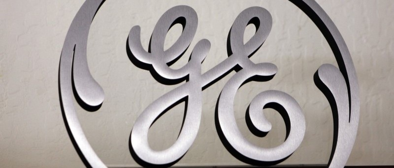 In this file photo taken Dec. 2, 2008, a General Electric (GE) sign is seen on display at Western Appliance store in Mountain View, Calif. (AP Photo/Paul Sakuma, File)