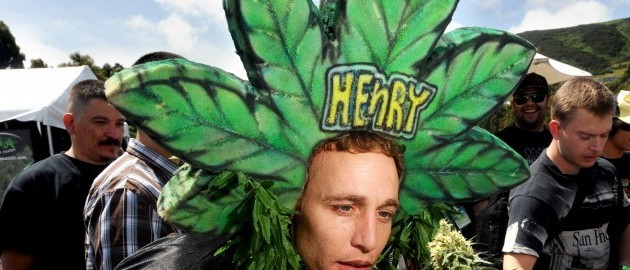 Magic Ellingson, who goes by Henry Hemp, smells a marijuana  plant at the International Cannabis & Hemp Expo on Saturday, April 17, 2010, in Daly City, Calif. (AP Photo/Noah Berger)