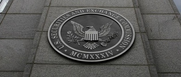 FILE- In this Dec. 17, 2008 file photo, the Securities and Exchange Commission (SEC) headquarters in Washington is shown. (AP Photo/File)