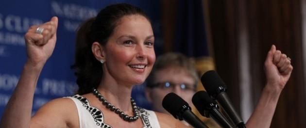 Actress Ashley Judd raises her arms in triumph as she speaks at the National Press Club in Washington, Wednesday, June 9, 2010. Judd discussed the controversial practice of mountain top removal coal mining in the Appalachian Mountains of Kentucky and West Virginia. (AP Photo/Pablo Martinez Monsivais)